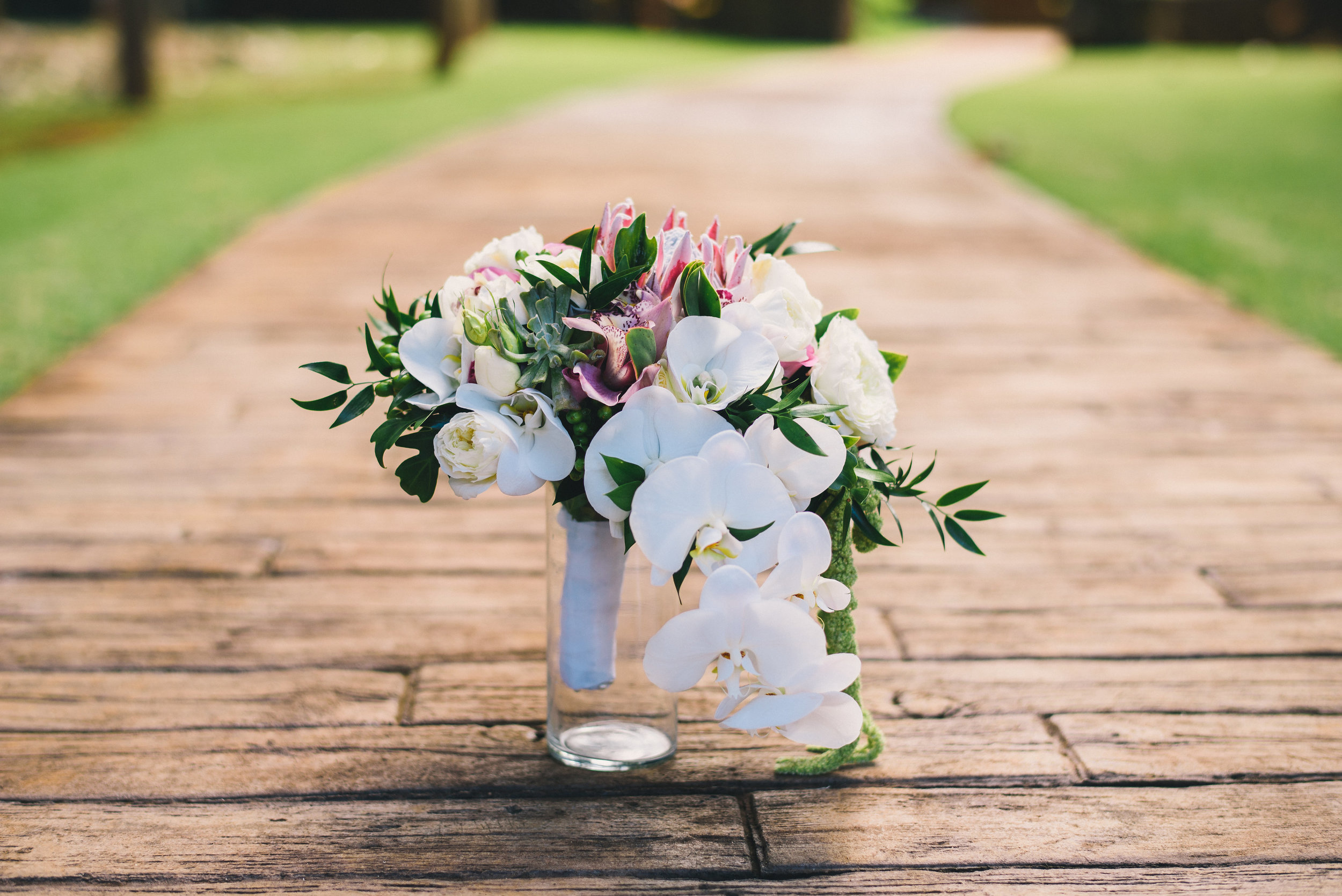 Elegant Bridal Bouquet Made With White Orchids and a King Protea Flower