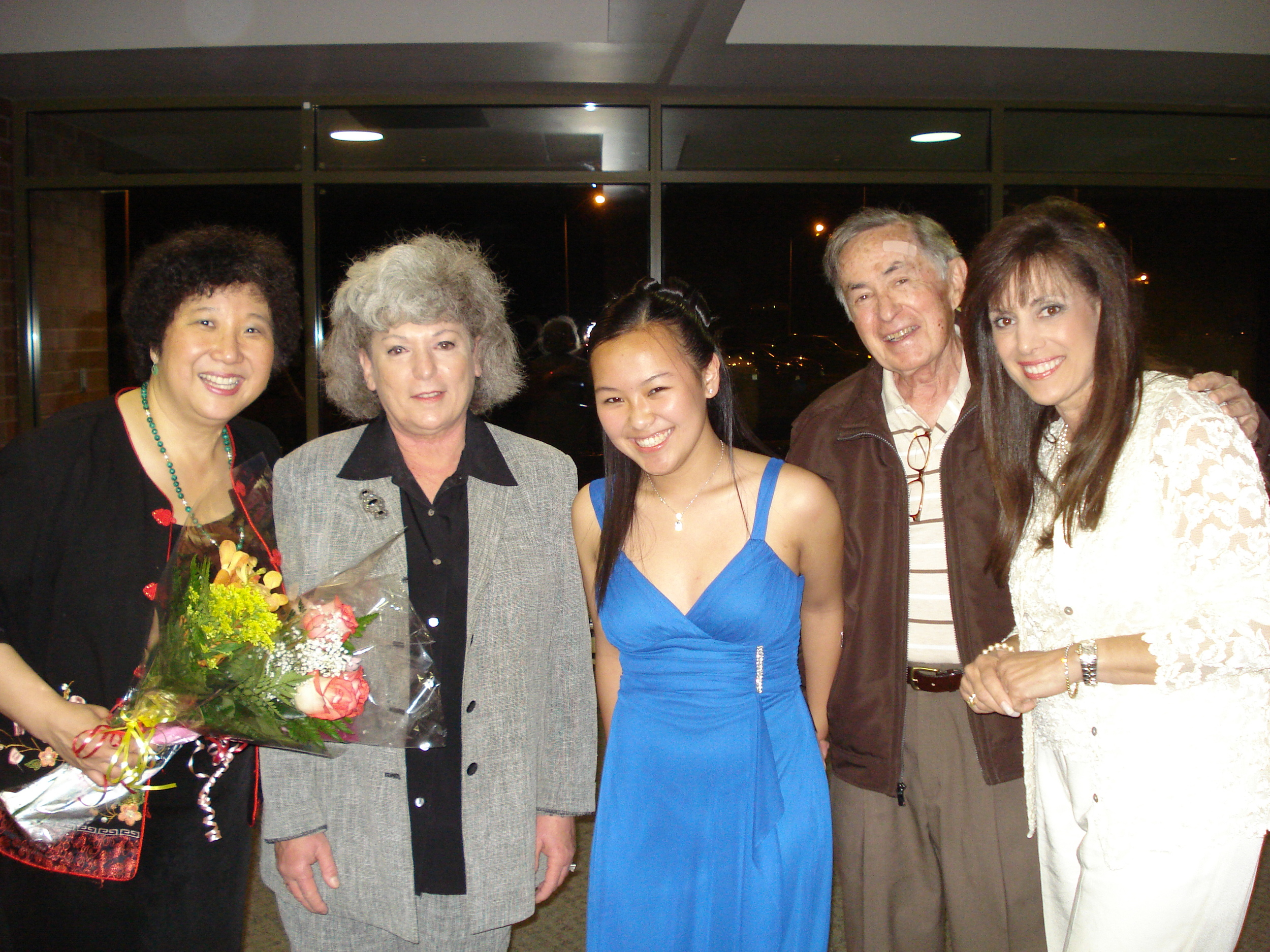Maestra Lin, Clarinetist Amy Zhang with members of the Monroe Township Arts Commision