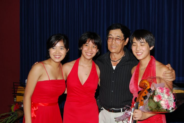 Violin teacher Hua-Yi Wang with the trio