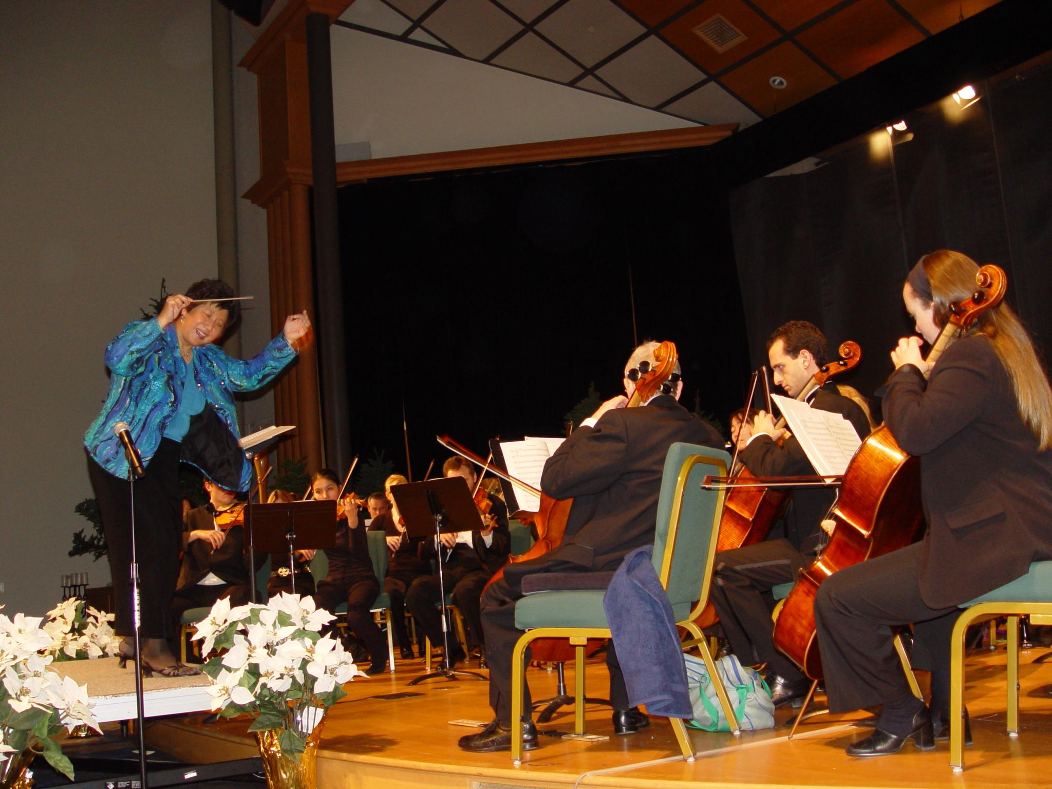 Maestra and orchestrahaving fun at performing