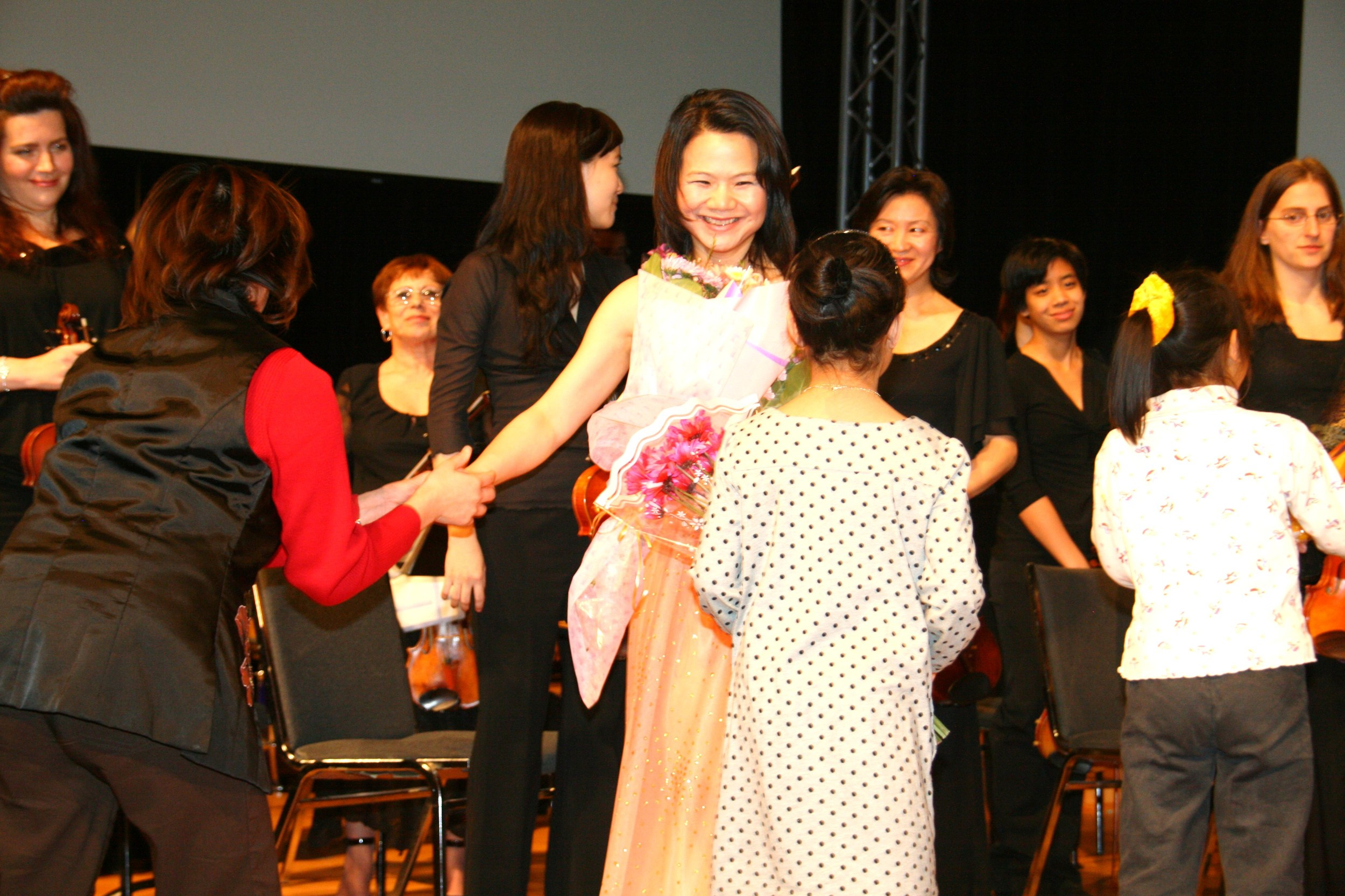 Stella Xu receiving flowers from her many admirers