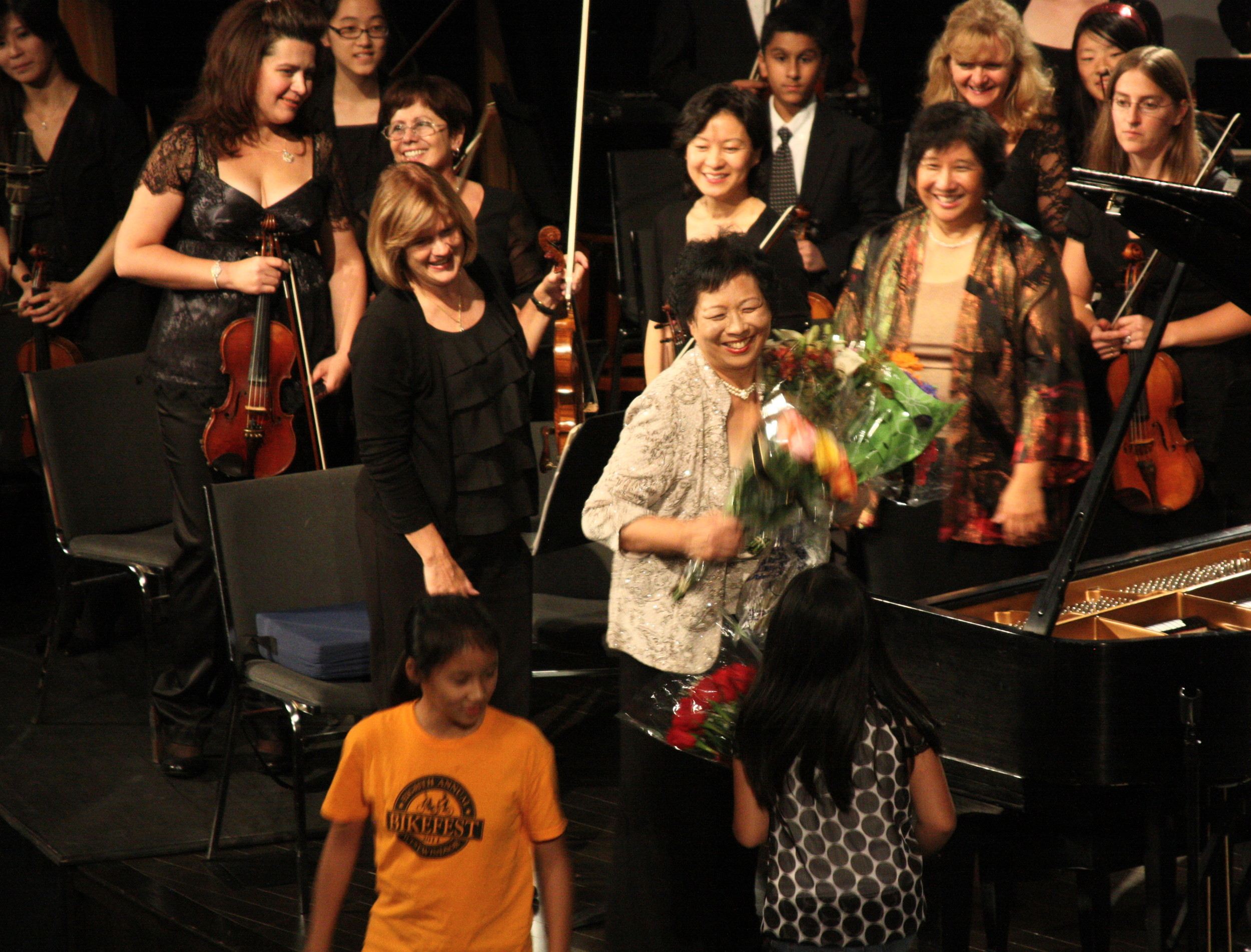 Chiu-Ling Lin joyfully receives flowers     from her students