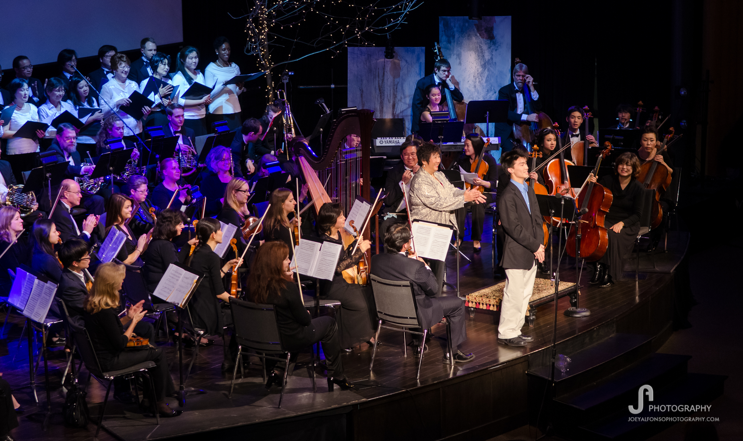 "Composer Matthew Liu bows after the premiere of ""A Christmas for Everyone"""