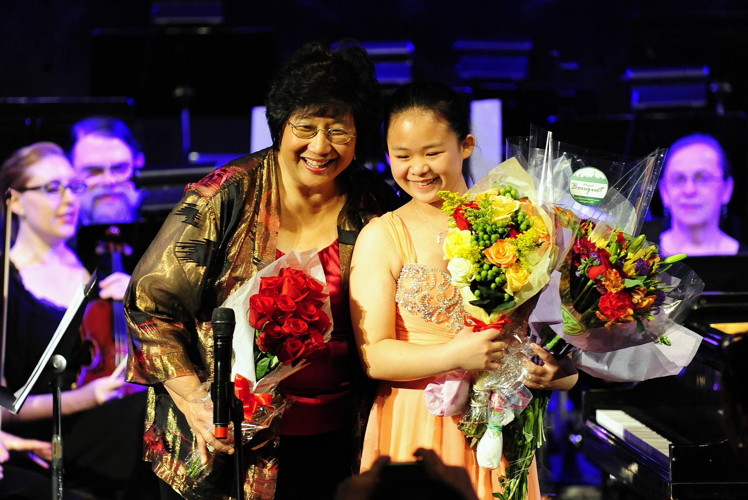Maestra Lin and Crystal Chiu receive flowers from their many admirers