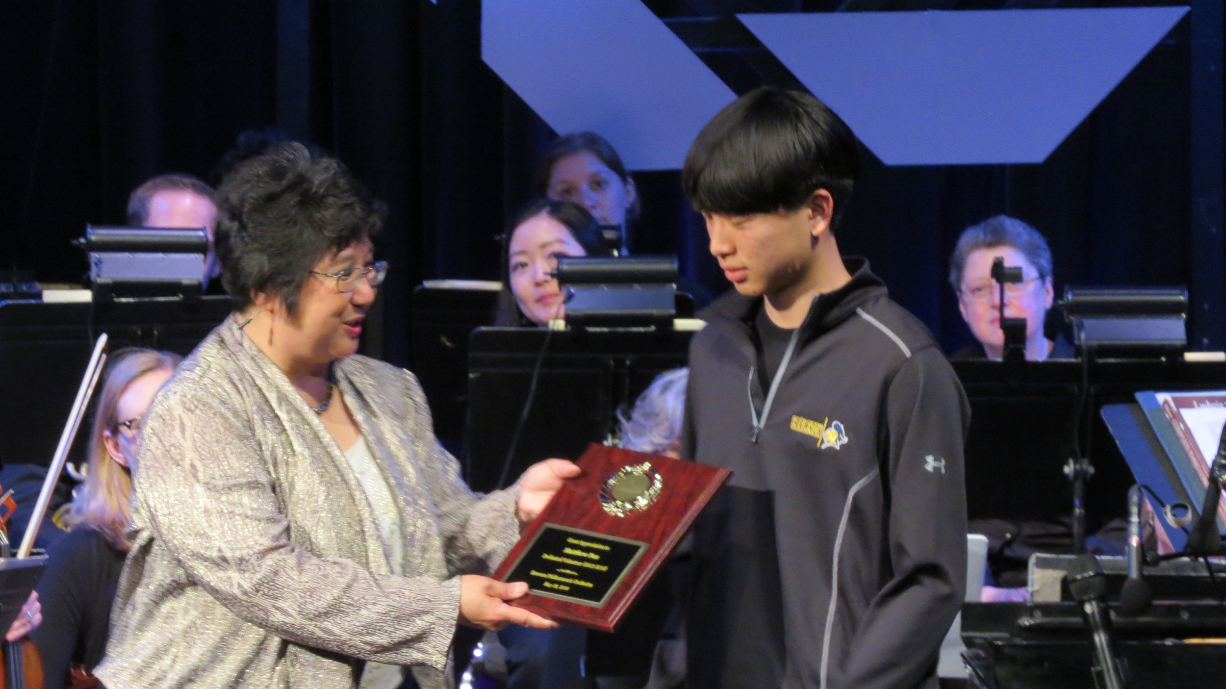 Acknowledging Matthew Pan for his dedicated volunteer work for the orchestra