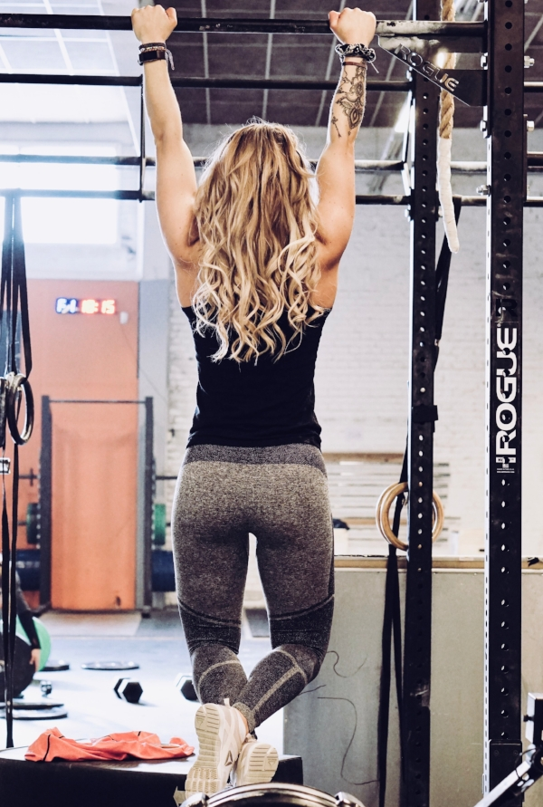 A bodyweight chin up is one of the most-popular training goals clients are working towards.