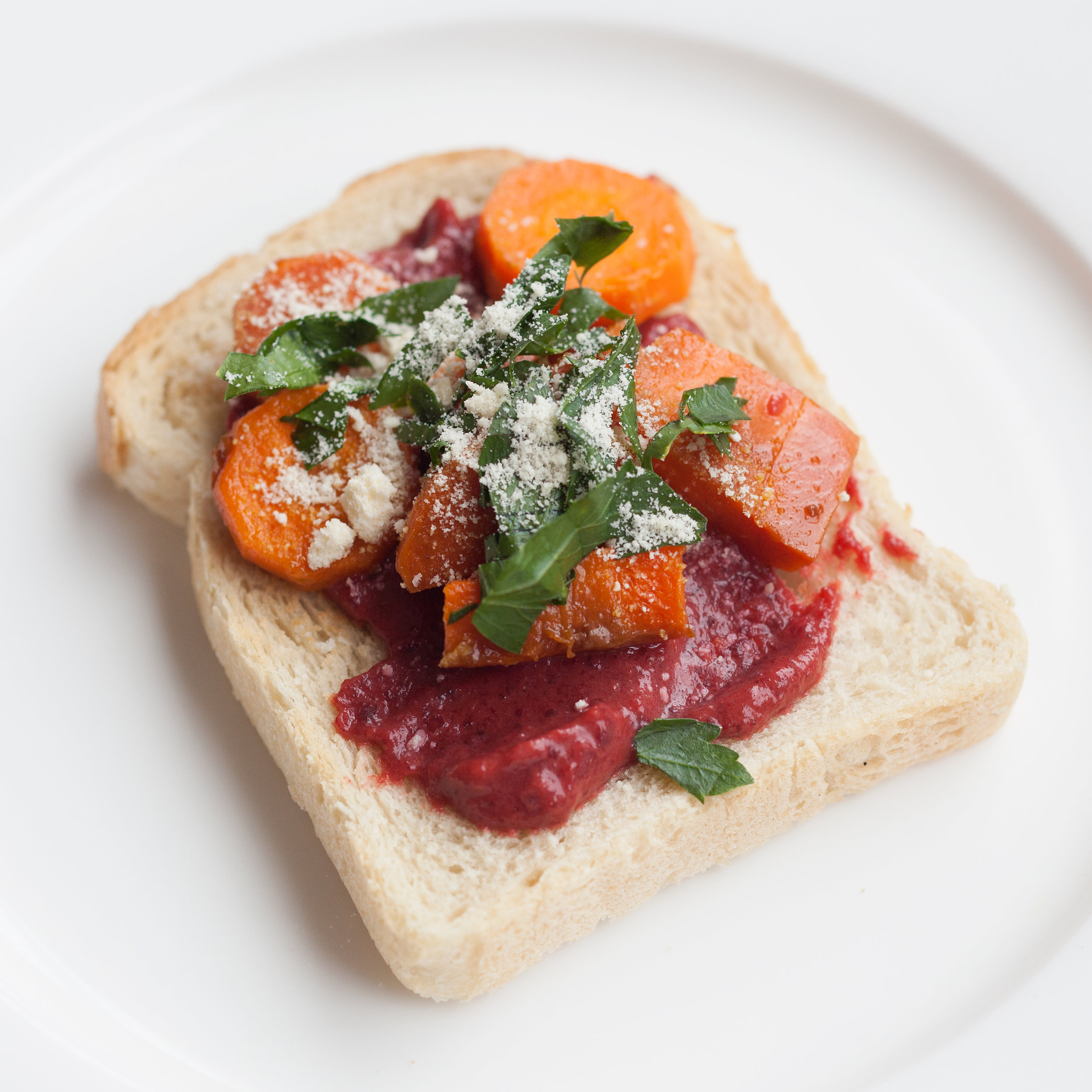 Smashed beetroot and carrots on toast.