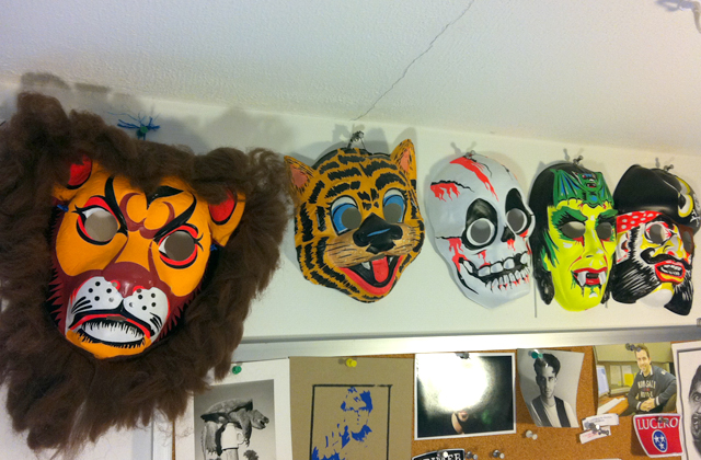 Vintage and reproduction retro masks above my studio table. I love the colors!