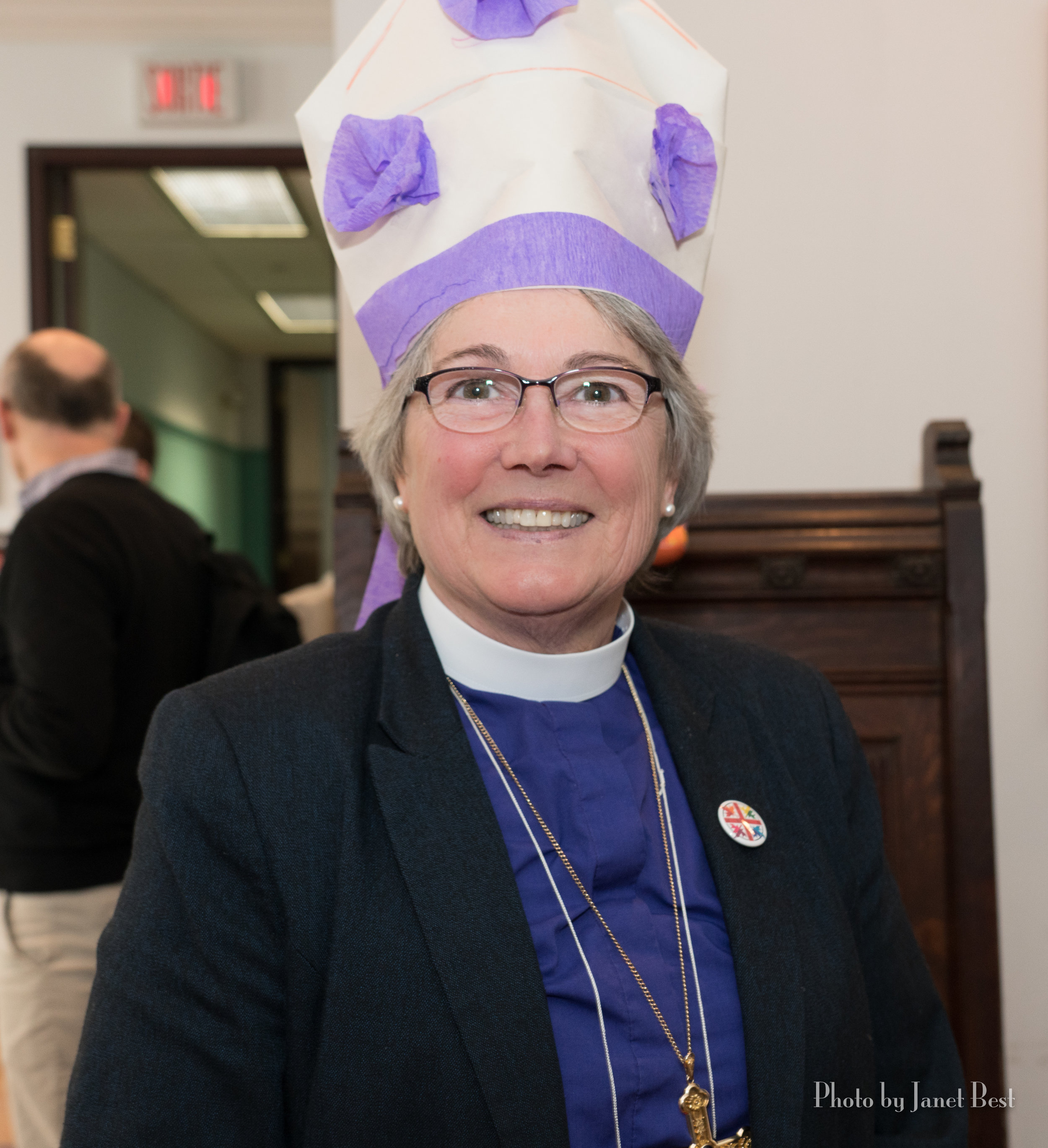 +Mary wears a hand crafted mitre!