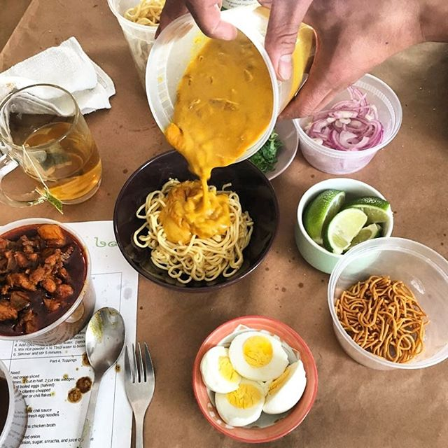 This is how we celebrate the end of our cooking class! Ohno Kao Swe/coconut curry chicken noodles. Coconut curry over fresh egg noodles. Curry chicken and all the toppings.  Thanks @megstemmler for a beautiful pic.  #burmesefood #cookingclass #burmanoodlebar #noodles #lunch