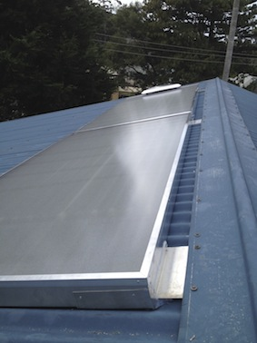 A 2 panel Ecoheat system (4.2m x 1m) on a happy customer's roof.