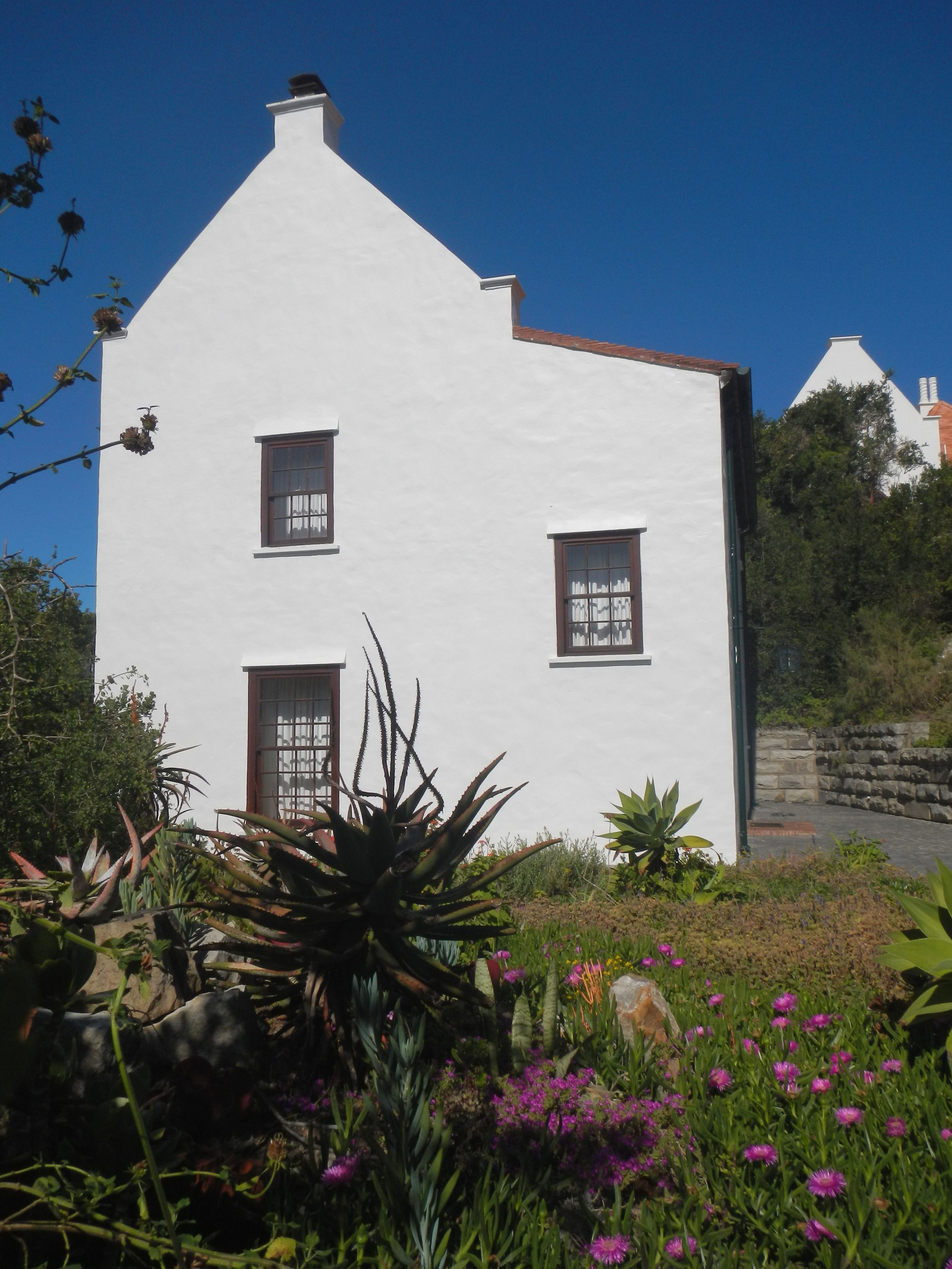Our cosy double storey cottage with harbour, sea and garden views