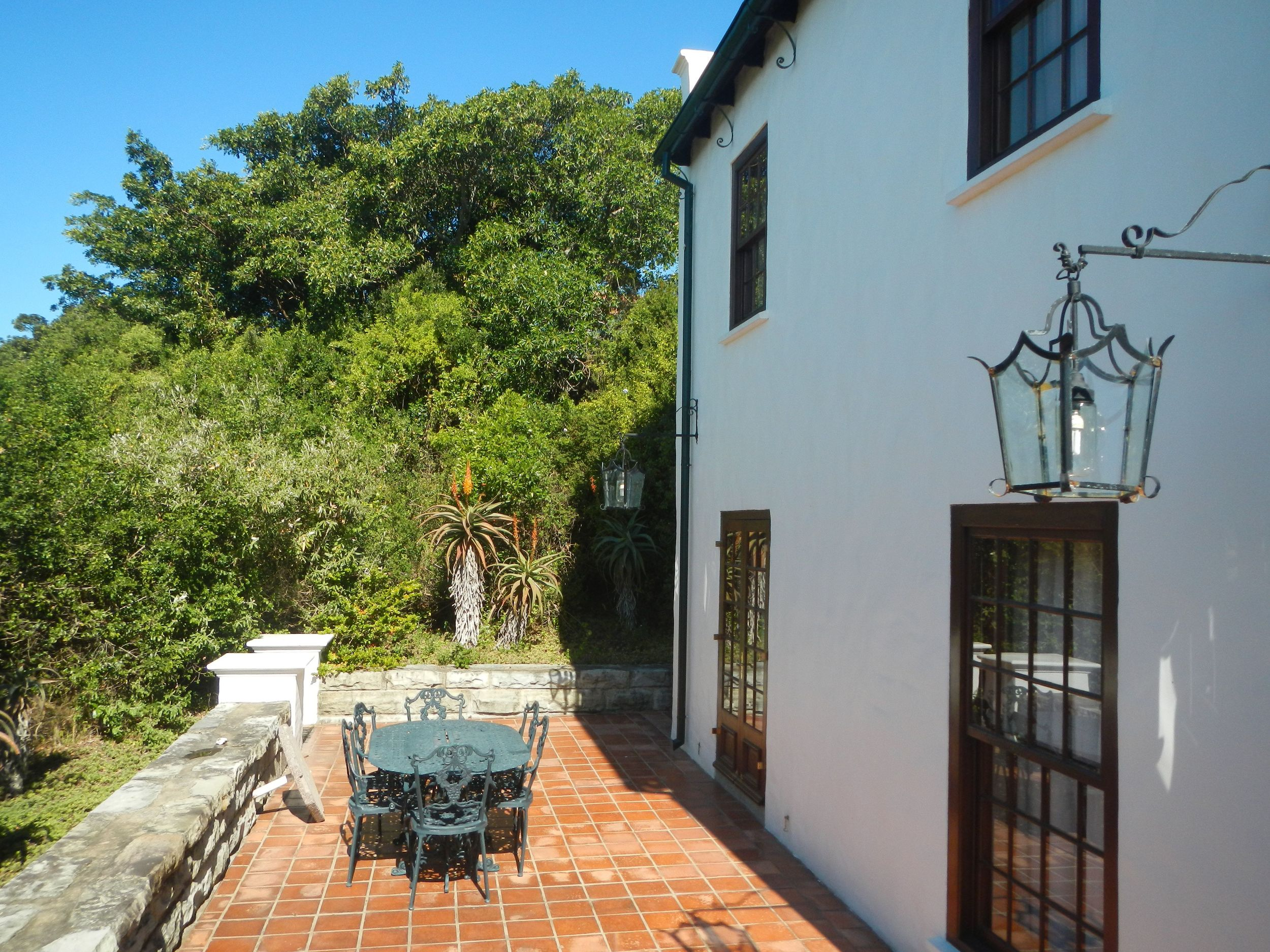The sheltered verandah is perfect for relaxing outdoors and braais (barbeues)