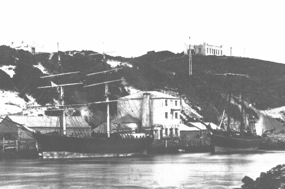 Earliest known photo (pre 1876) of The Castle on the hill and Cock's Mill on the river