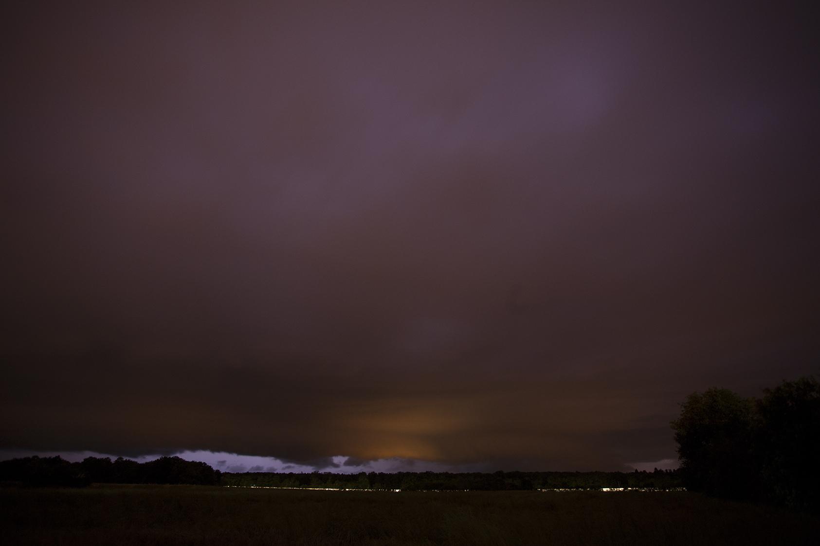 Night train from Paris to Lyon passing lightning storm