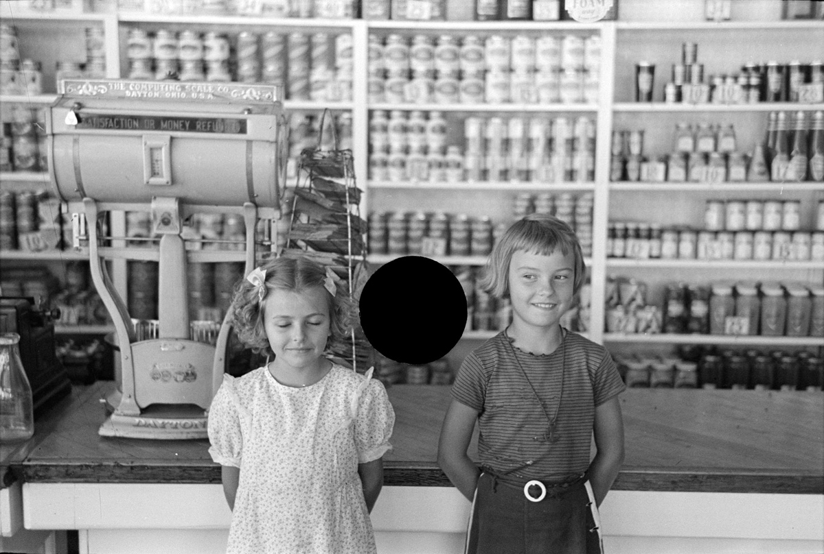 Untitled photo, possibly related to nearby photo captioned: Corner of general store, Ericsburg, Minnesota. August, 1937.