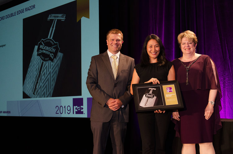 Wilkinson Sword's Double Edge Razor won Gold. San Yee Nye, VP Account Director, accepts the award onstage.