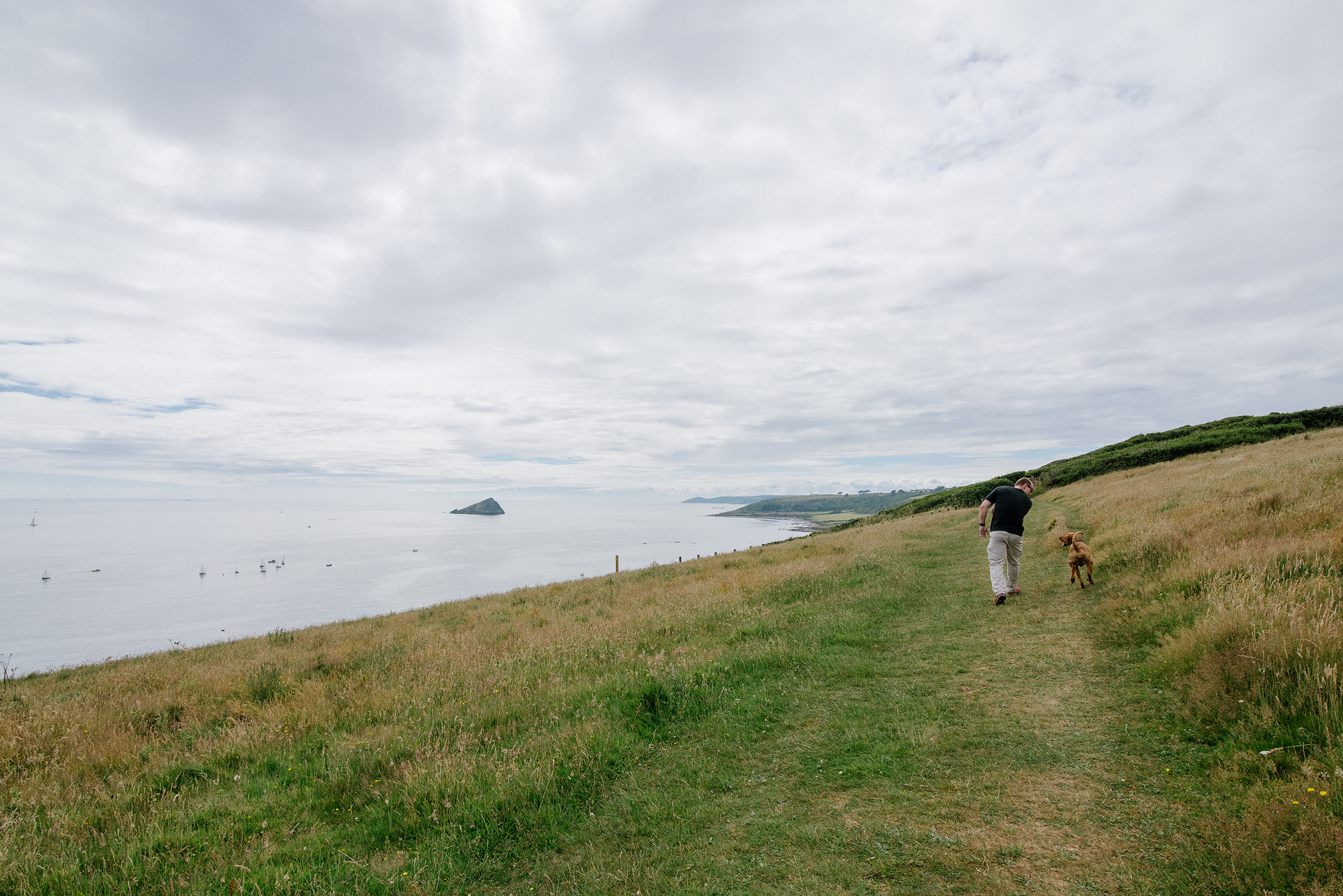 A man and (not) his dog along the British coastline