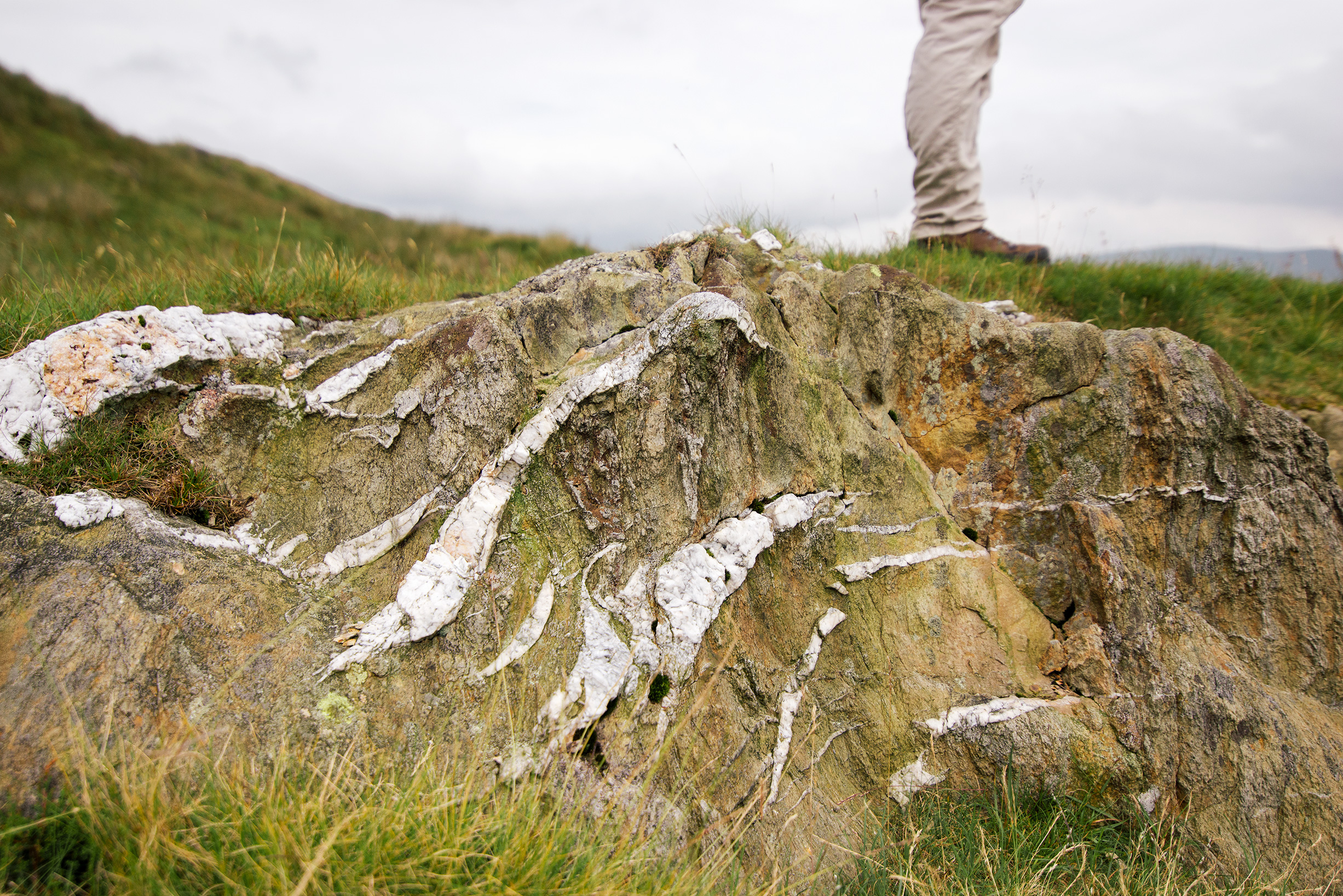 Rock patterns and hiker in the Lake District, United Kingdom