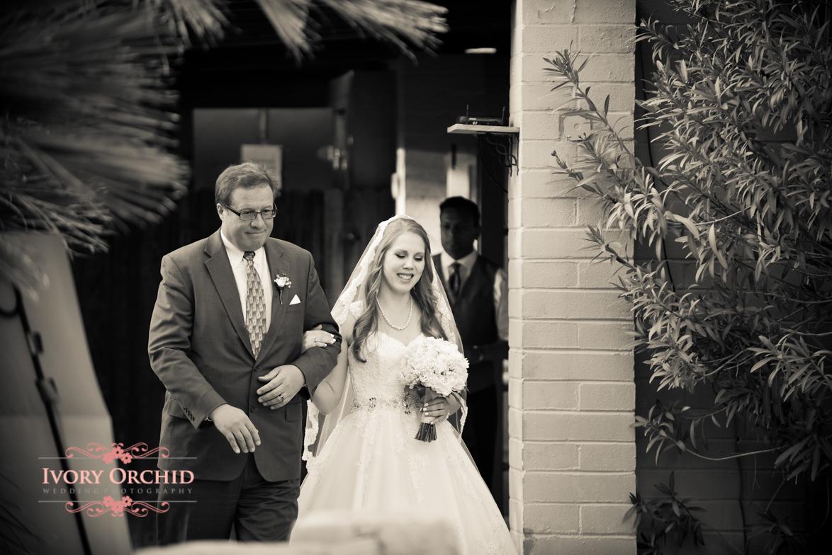 Dad bringing bride down isle