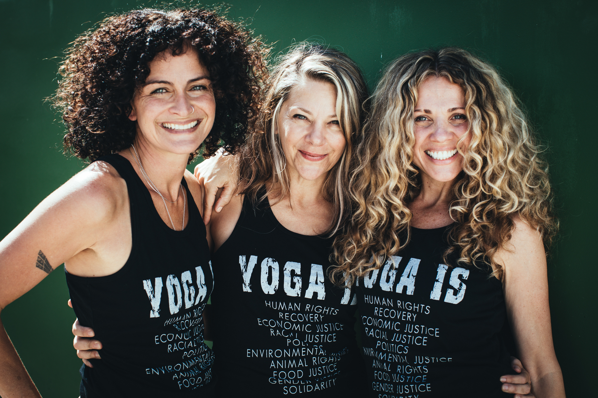 Seane Corn   ,    Hala Khouri, M.A.   , &    Suzanne Sterling     are internationally known for their yoga practice as activism work. Committed to conscious, sustainable social change, the trio launched OTM in 2007 as a global community-focused leadership training organization for activists.  Meet the rest of our team here.