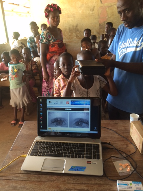 Patients are enrolled using a picture of their eyes. The system is easy to use and portable. This photos shows parent volunteers helping with malaria screening in theirchildren's school.