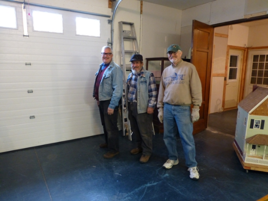 Volunteers Scot McCollum, George Italiano and Bob Mullen in the garage at West Ave where large artifacts will be stored.