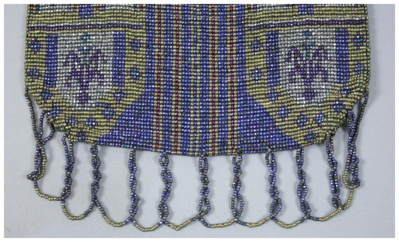A close up of beaded fringe.