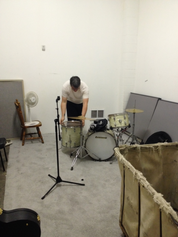 Bob sets up his drums.
