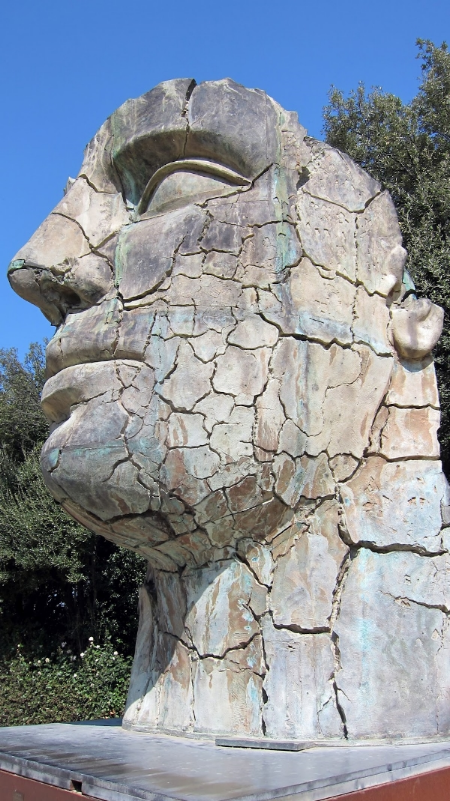 All of a sudden we discovered a statue of a crumbling head.
