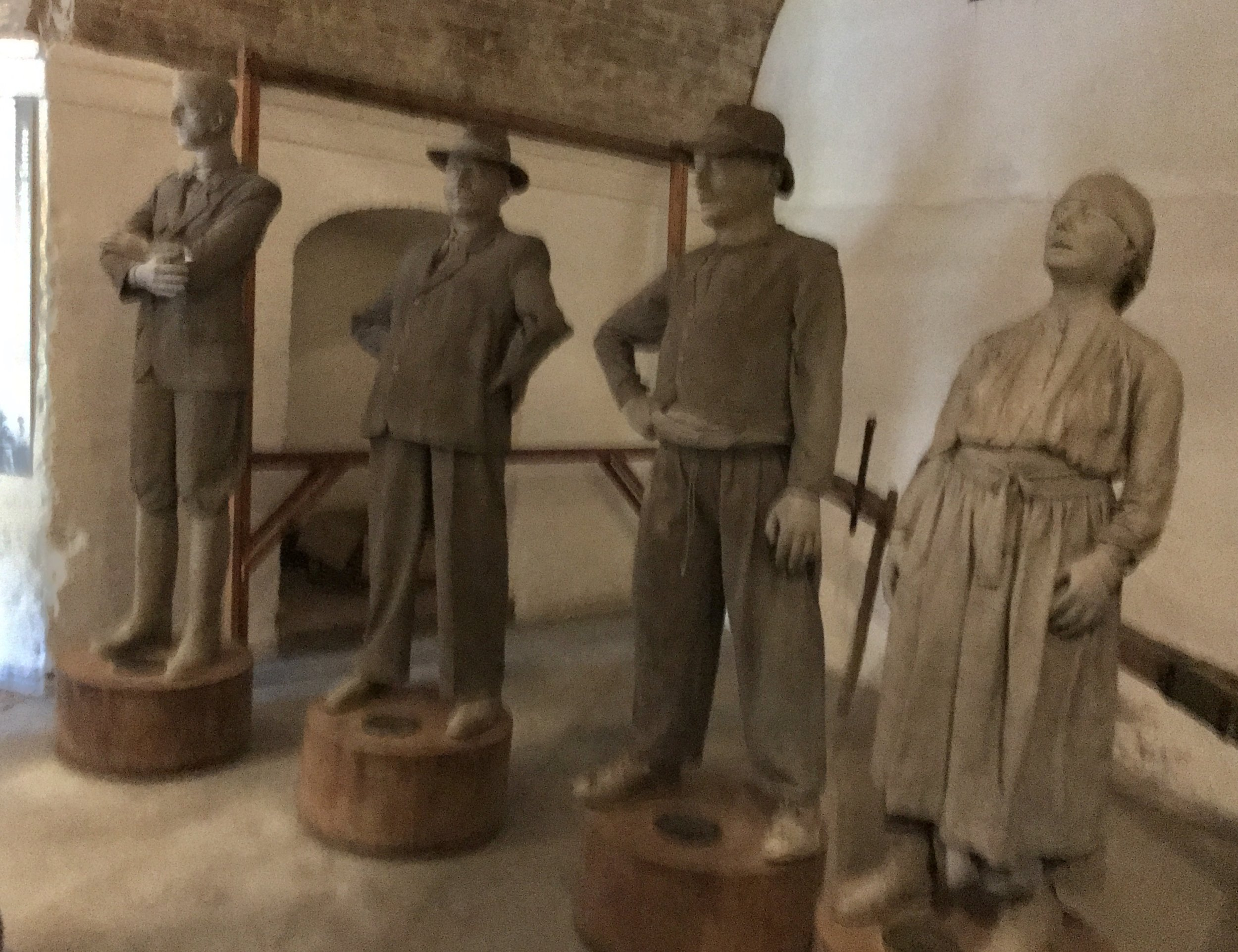 left to right; the land owner, the supervisor and the farm workers, also known as share croppers.