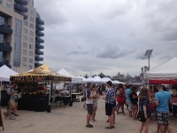 Smorgasburg- a parking lot of delicacies, with the backdrop of condominiums