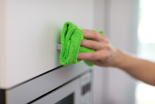 Pro tip: Color code your cloths to avoid cross-contamination. We like to follow a traffic light system: red for the bathroom, yellow for the kitchen, and green everywhere else.