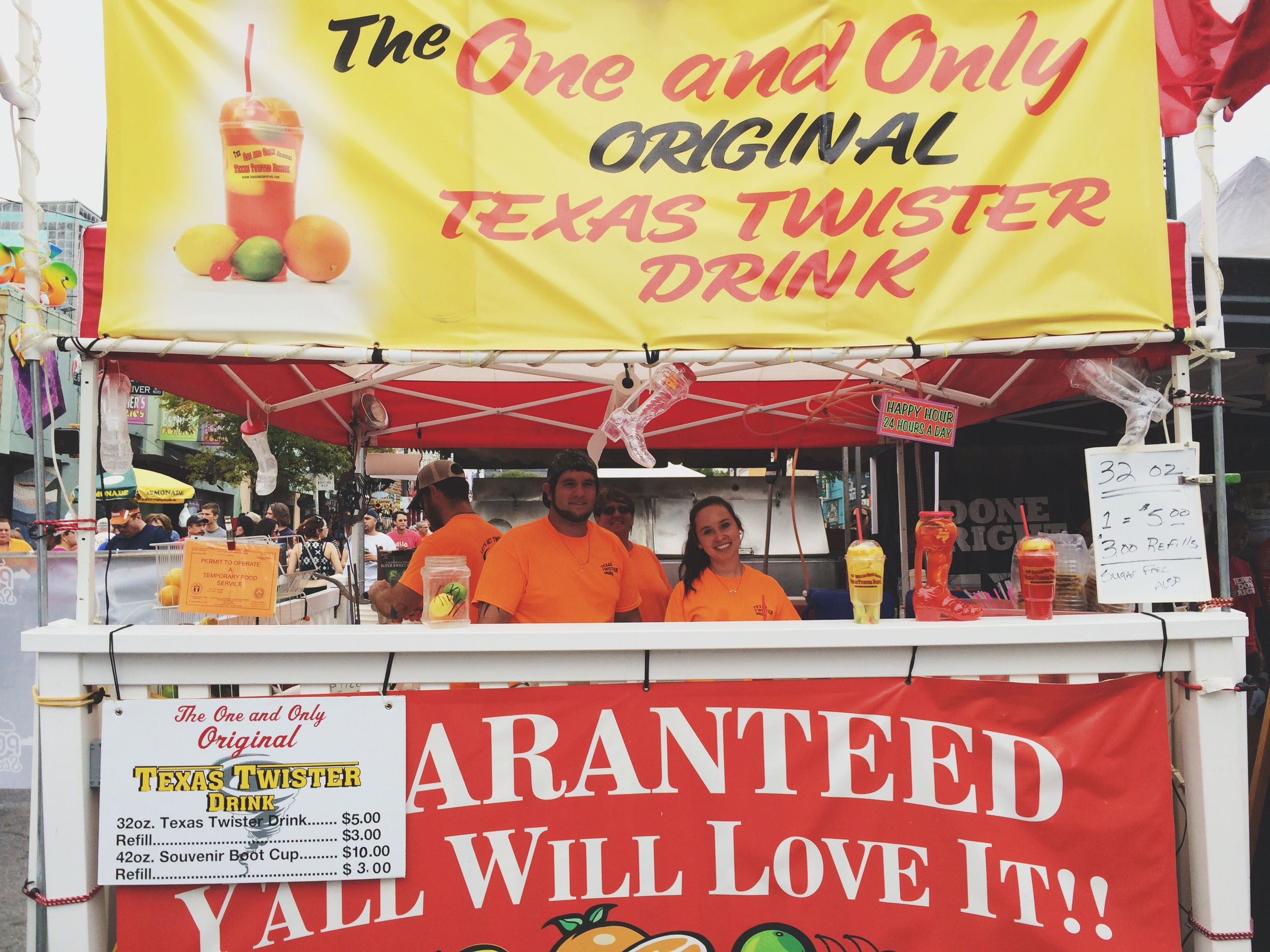 Wandered to 6th Street Pecan Festival, this drink stand, so very Texas.