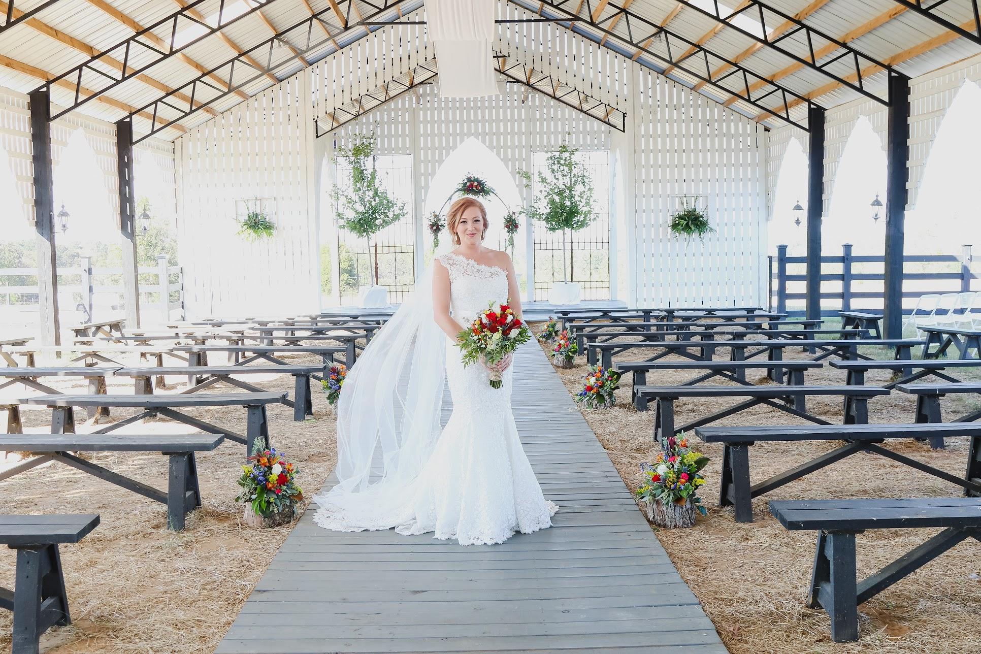 bride in chapel wedding dress one shoulder dress