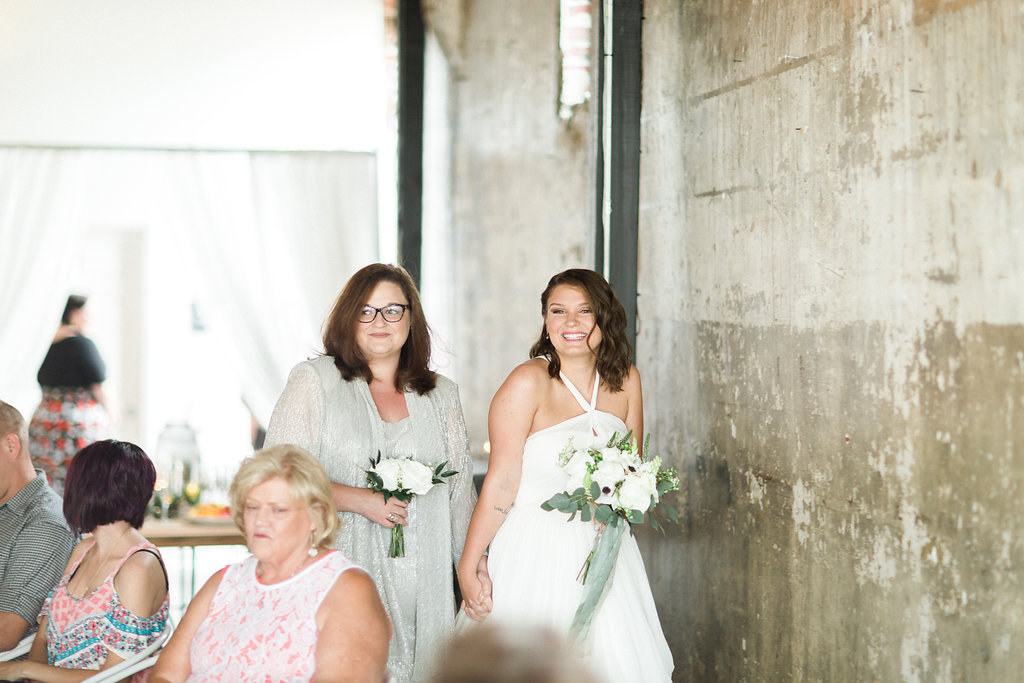 mother daughter walking down the aisle