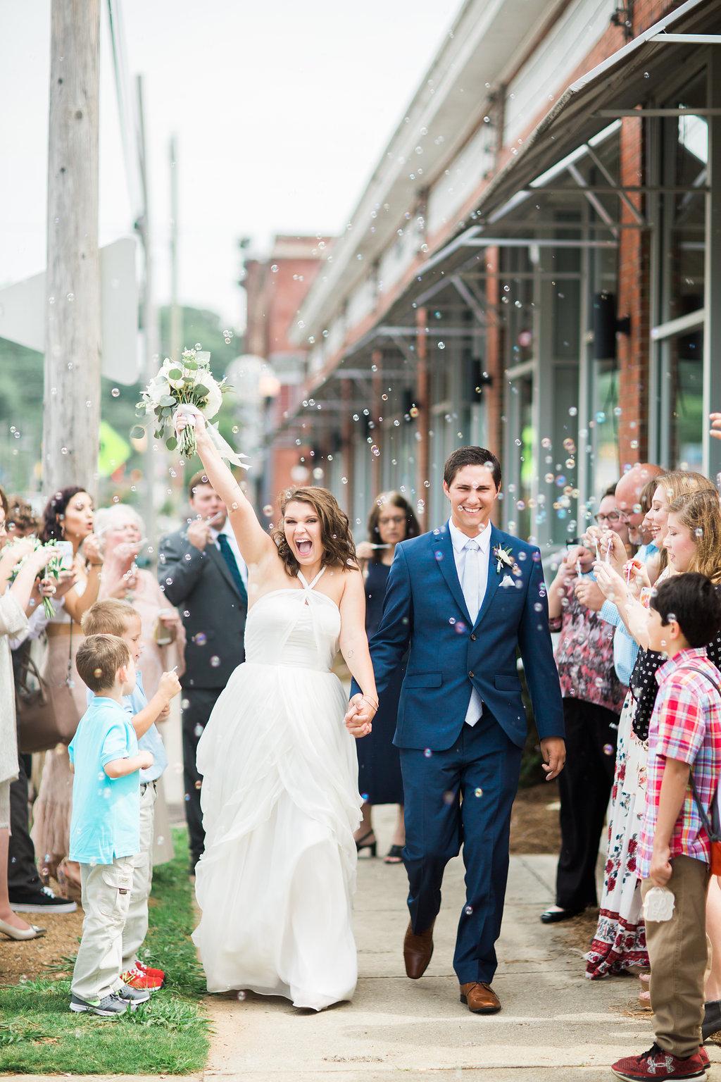 bride and groom bubble send off