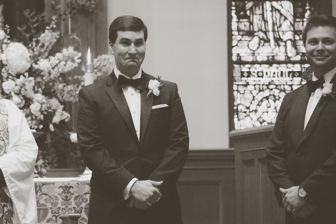 black and white groom first look