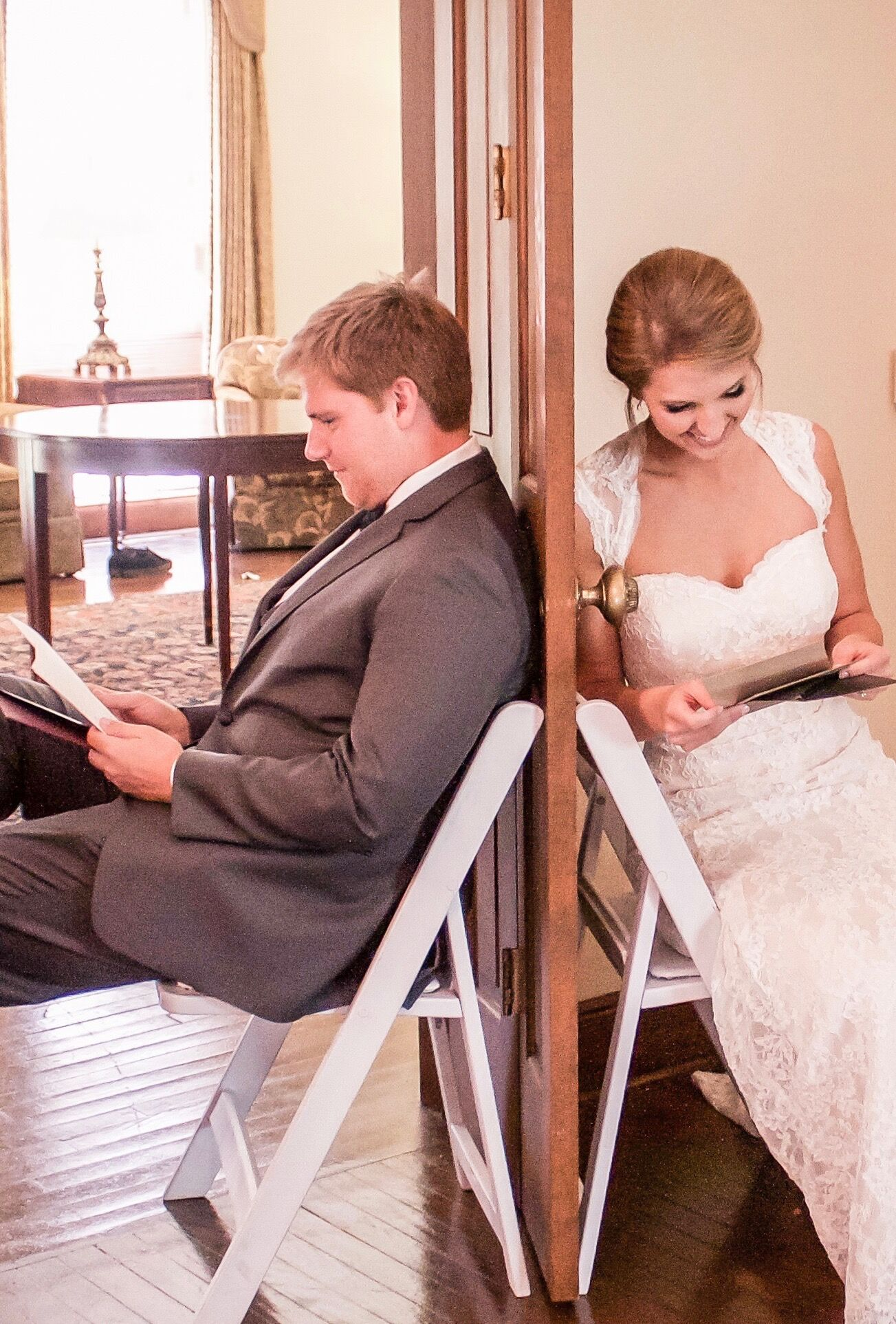 bride and groom reading love letters
