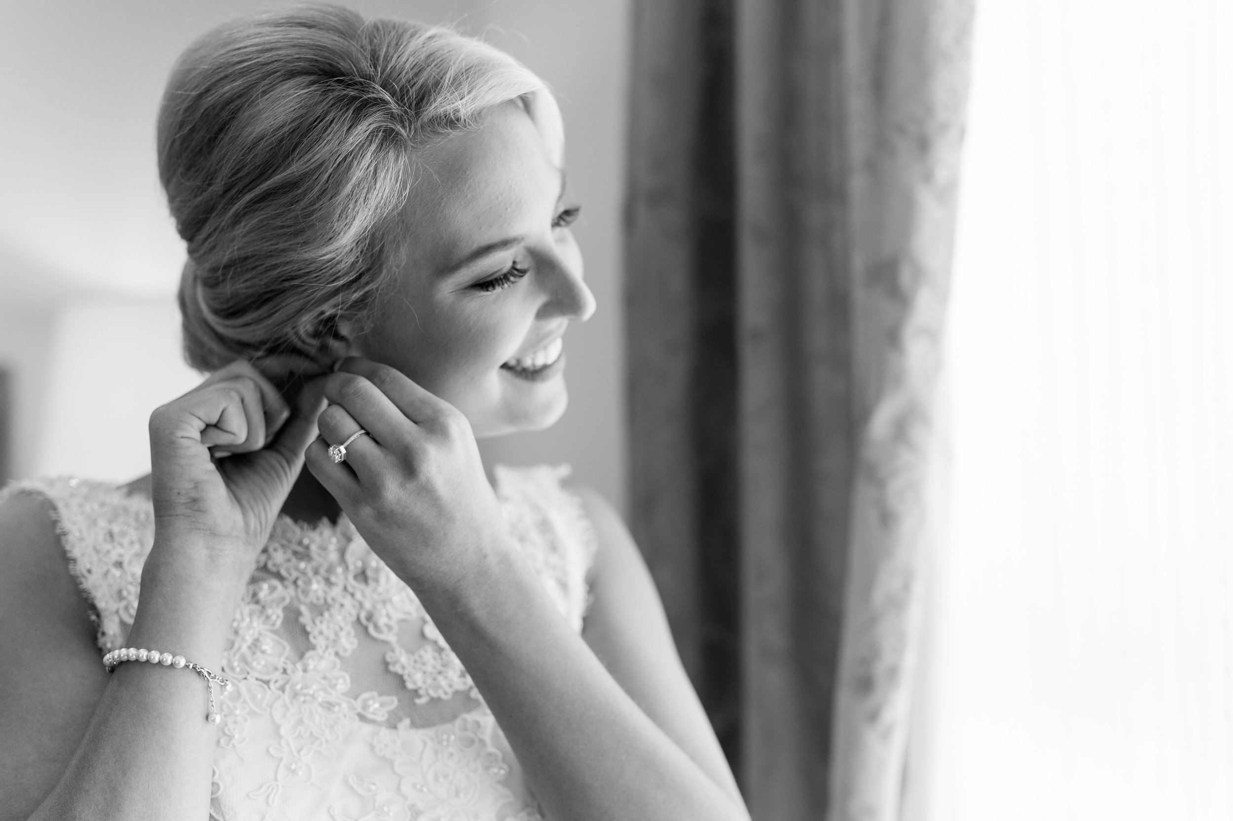 bride getting ready black and white photo