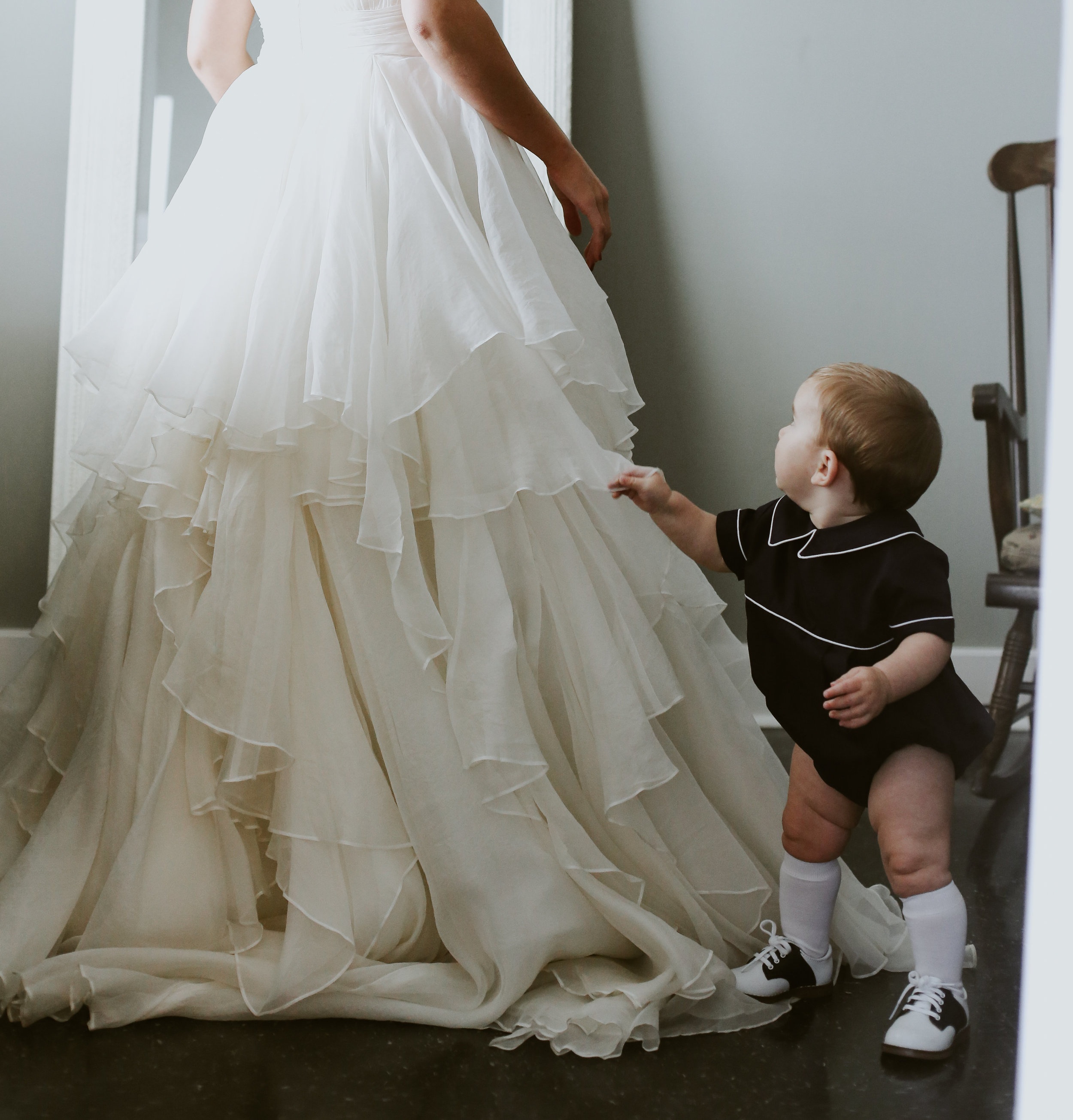 sweet moment bride and son white wedding dress