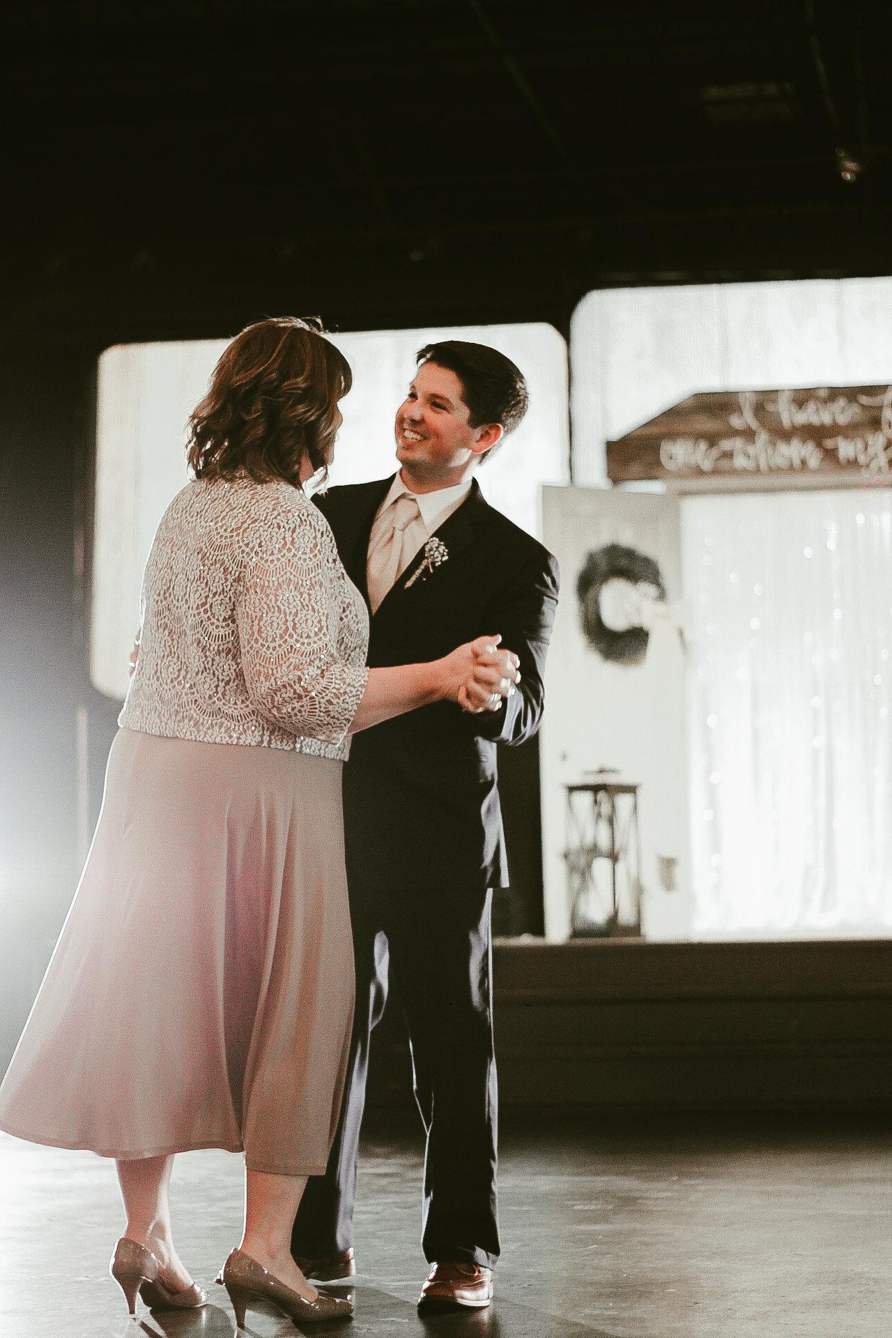 Ansley Wedding-first dance cake cutting-0087.jpg