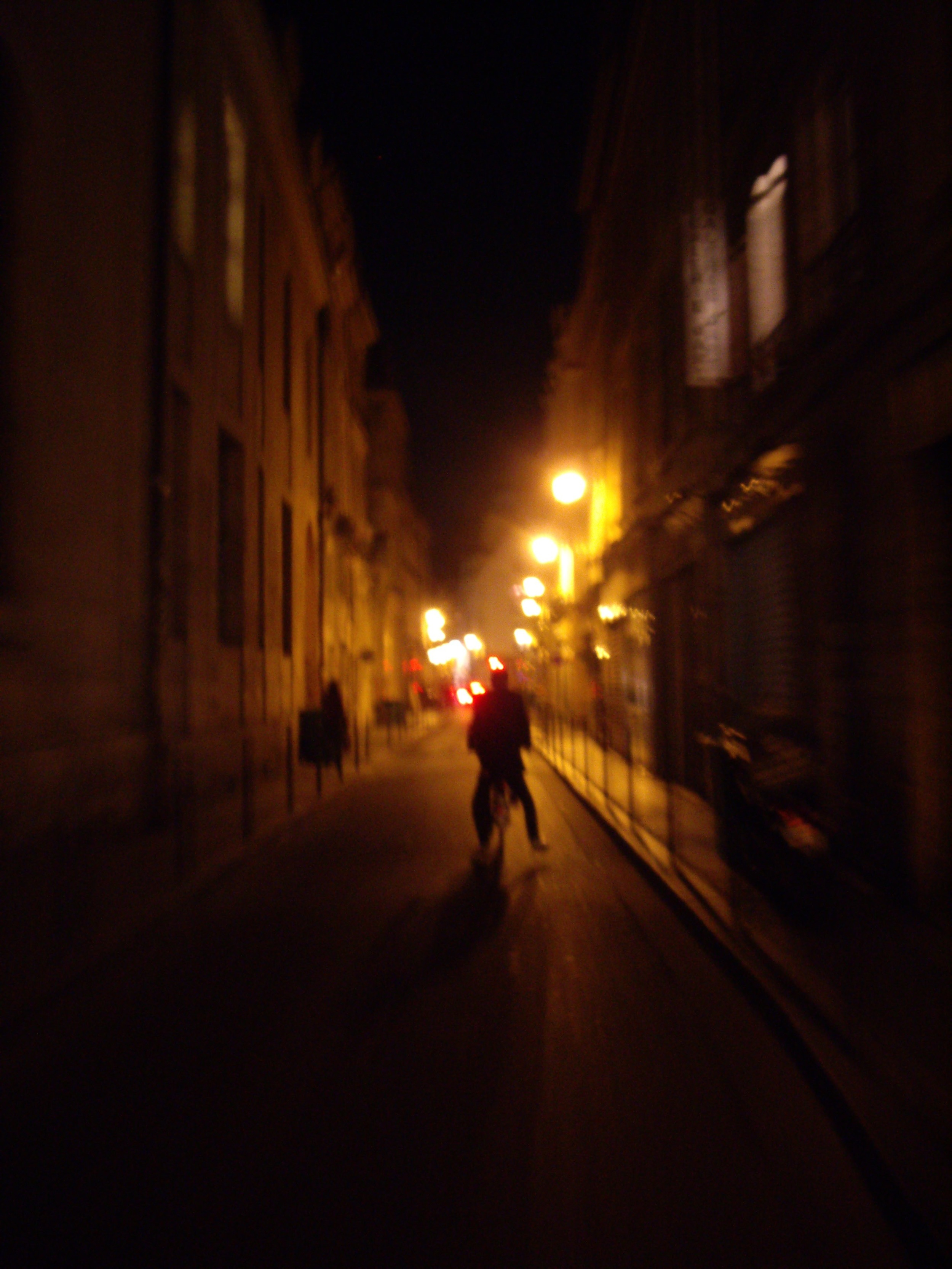 This is a picture I took of Joe Tang, riding bikes through the Marais.