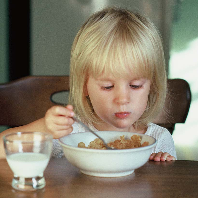 Me, eating Corn Flakes, circa 1980.