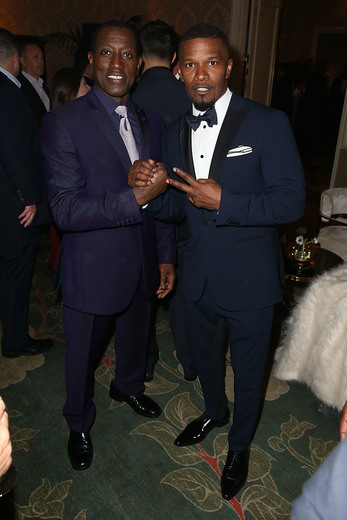 Wesley Snipes and Jamie Foxx attend the Mercedes-Benz and African American Film Critics Association Oscar viewing party at Four Seasons Hotel Beverly Hills on February 28, 2016 in Los Angeles, California. Photo Credit: Joe Scarnici/Getty Images for Mercedes-Benz USA.