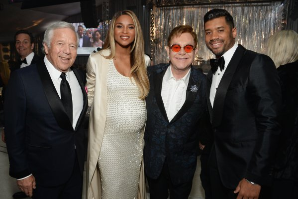 WEST HOLLYWOOD, CA - FEBRUARY 26: (L-R) New England Patriots CEO Robert Kraft, recording artist Ciara, host Elton John, and NFL player Russell Wilson attend the 25th Annual Elton John AIDS Foundation's Academy Awards Viewing Party at The City of West Hollywood Park on February 26, 2017 in West Hollywood, California. (Photo by Michael Kovac/Getty Images for EJAF)