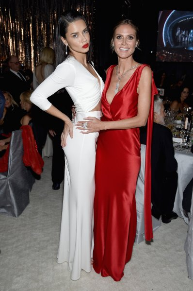 Models Adriana Lima (L) and Heidi Klum attend the 25th Annual Elton John AIDS Foundation's Academy Awards Viewing Party at The City of West Hollywood Park on February 26, 2017 in West Hollywood, California. (Photo by Dimitrios Kambouris/Getty Images for EJAF)