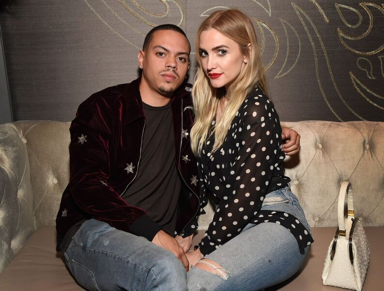 Evan Ross gives wife Ashlee Simpson a kiss at the TAO, Beauty & Essex, Avenue, and Luchini LA Grand Opening.Photo Credit: Michael Kovac/Getty Images