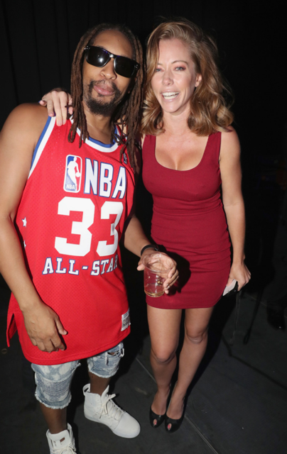 Kendra Wilkinson and old friend Lil Jon caught up at  Thomas J. Henry Law Firm's  celebration of 25 Years Of Excellence. Photo Credit: Johnny Nunez/Getty Images