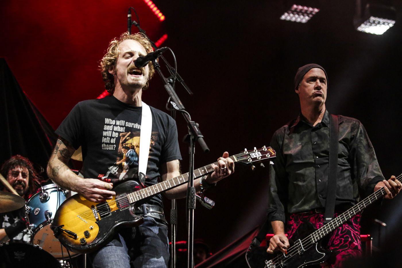 John McCauley, center, plays with Dave Grohl, left, and Krist Novoselic of Nirvana at Saturday's Cal Jam festival. Photo Credit: Maria Alejandra Cardona / Los Angeles Times.